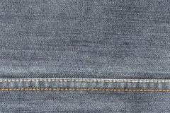 Fabric pattern seam texture of denim or blue jeans. Stock Photo