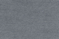 fabric pattern texture of denim or black jeans. Royalty Free Stock Photography