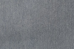 Fabric pattern texture of denim or black jeans. Royalty Free Stock Photos