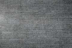 fabric pattern texture of denim or black jeans. Royalty Free Stock Images