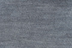 Fabric pattern texture of denim or blue jeans. Royalty Free Stock Photography