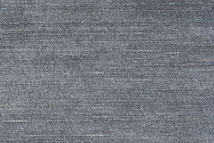 Fabric pattern texture of denim or blue jeans. Stock Photos