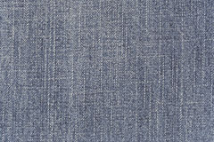 Fabric pattern texture of denim or blue jeans. Royalty Free Stock Image