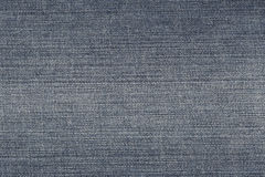 Fabric pattern texture of denim or blue jeans. Royalty Free Stock Images