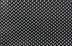 Fabric with a pattern of white diamond. Dark fabric with a pattern of white diamond shapes for background Stock Image