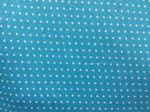 Fabric pattern white dots on a cyan background Stock Images