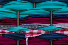 Fabric Pieces Wrapped Between Metal Fence Texture Macro Stock Image