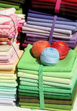 Fabric Pile. Piles of colorful fabrics and yarns in a store window royalty free stock photo