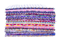 Fabric. Pile of colorful checkered plaid fabric background Stock Photography