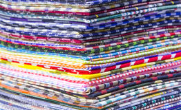Fabric. Pile of colorful checkered plaid fabric background Royalty Free Stock Photography
