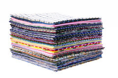 Fabric. Pile of colorful checkered plaid fabric background Royalty Free Stock Photos