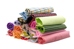 Fabric. Pile of colorful checkered plaid fabric roll on a white background Stock Image
