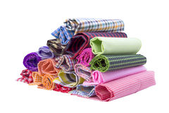Fabric. Pile of colorful checkered plaid fabric roll on a white background Royalty Free Stock Image