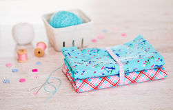 Fabric Pile of colorful folded textile with sew items Royalty Free Stock Photo