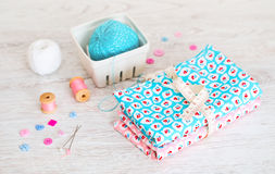 Fabric Pile of colorful folded textile with sew items Stock Images