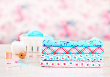 Fabric Pile of colorful folded textile with sew items Royalty Free Stock Images