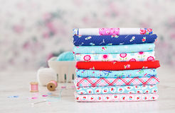 Fabric Pile of colorful folded textile with sew items Stock Photography