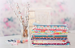 Fabric Pile of colorful folded textile with sew items Stock Image