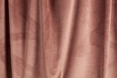 Fabric pink velvet. Close-up view of an old pink velvet curtain. Minimal color still life photography stock photo