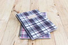 Fabric plaid texture cover spiral notebook. Royalty Free Stock Images