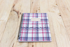 Fabric plaid texture cover spiral notebook. Stock Image