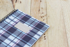 Fabric plaid texture cover spiral notebook. Royalty Free Stock Photography