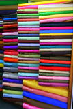 Fabric in plain colours. Skeins of plain colour fabrics for sale in a fabric shop Stock Images