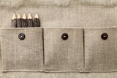 Fabric pocket. And wooden pencils Stock Photos