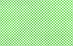Fabric with polka dots. White fabric with green polka dots royalty free stock image