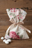 Fabric pouch wedding favor. On old wooden table stock photography
