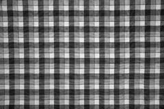 Fabric print with black and white grid Stock Images