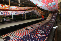 Fabric printing. Workers are giving the motif fabric printing in Sukoharjo, Central Java, Indonesia royalty free stock photos