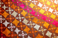 Fabric from punjab, the needlework. Overall view of the texture and the colours of a shawl from punjab, landscape cut Stock Images