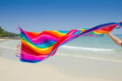 Fabric rainbow on the beach Royalty Free Stock Photos