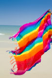 Fabric rainbow on the beach Royalty Free Stock Images