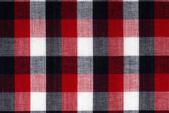 Fabric into red grid, a background Royalty Free Stock Image