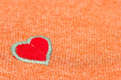 Fabric red  heart. Old cloth details with fabric red  heart Royalty Free Stock Photography