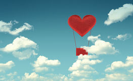 Fabric red heart air balloon on blue sky background Stock Photography