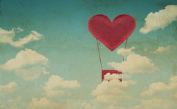 Fabric red heart air balloon on blue sky background Royalty Free Stock Photos
