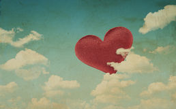 Fabric red heart on blue sky background Royalty Free Stock Photography