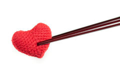 Fabric red heart with chopstick isolated. Fabric red heart with chopstick isolated on white background Stock Image
