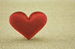 Fabric red heart shape on gold background Stock Photo
