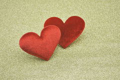 Fabric red heart shape on gold background Stock Images