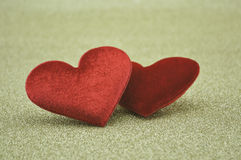 Fabric red love heart shape on gold background Stock Photo