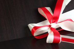 Fabric ribbon scene. The red and white color fabric ribbon represent the gift and present background concept related idea Stock Photography