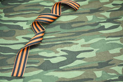 Fabric with ribbon. Striped ribbon in celebration, in honor of the memory of the victims Royalty Free Stock Photo