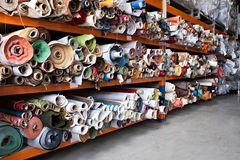 Fabric rolls. Interior of a industrial warehouse with fabric rolls Stock Photos