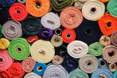 Fabric Rolls. Colorful fabric rolls at fabric market Stock Photos
