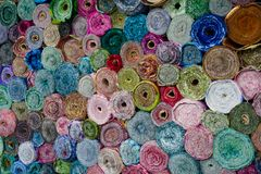 Pattern background of fabric rolls at market stall royalty free stock images