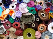 Fabric rolls. Rolls of fabric stacked in the van at the end of market day Stock Photography